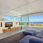 "alt=""SMARTHOMEWORKS - smarthome home automation Sydney - spacious living room overlooking the beach"""