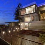 "alt=""SMARTHOMEWORKS - smarthome home automation Sydney - stone themed house rear view"""